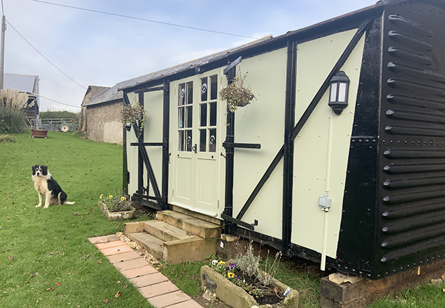 Stay in the charming railway carriage at Higher Biddacott Farm.