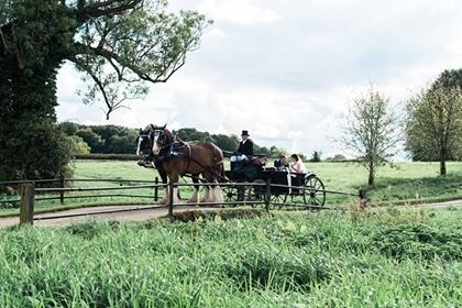 Feel like a true princess on your wedding day with a horse drawn carriage.
